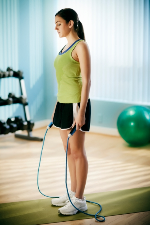 Young Woman Preparing to Jump Rope